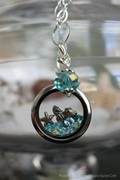 This lovely crystal dangle is being retired to make way for *new* product!  A lovely beach-themed locket!  #ThinkSpring #OrigamiOwl #LivingLockets www.chrissypagnotti.origamiowl.com