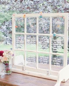 You can transform an old window   into a unique escort card display by using a white paint pen to write guests' names and table numbers
