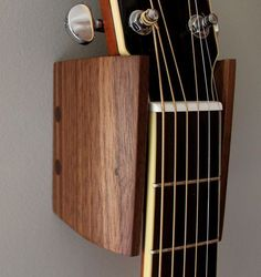 I made these guitar hangers out of black walnut. It's a pretty simple DIY project easily completed in one weekend. These guitar hangers are designed for my son's Yamaha acoustic guitars but the measurements could easily be adjusted to fit most guitars simply by changing the width of the back piece. This is one of those projects where it's good … #WoodworkingProjectsGuitar