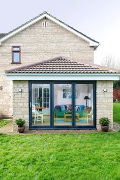 Front view from garden of an Everest Tiled Roof Extension with closed Bi Fold doors Pergola With Roof, Patio Roof, Pergola Plans, Pergola Ideas, Conservatory Ideas Sunroom, Conservatory Extension, House Extension Design, Roof Extension, Garden Room Extensions