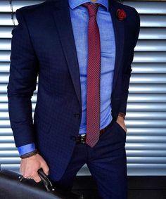 Light blue shirt / dark blue suit / red tie.