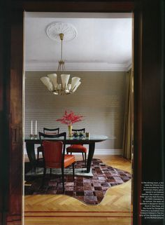 This lovely dining room features a 1945 Vittorio Dassi table surrounded by 1940s American Edelman leather upholstered chairs, a Kyle Bunting cow-hide rug and a 1960 Kalmar chandelier.