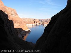 12 Places Worth Visiting at least 10 Miles down a Dirt Road - Hole in the Rock near sunset, Glen Canyon National Recreation Area, Utah