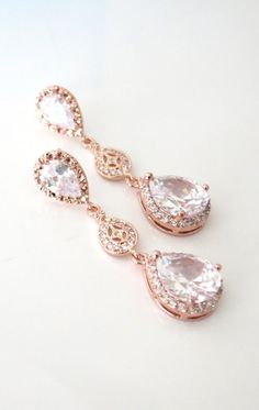 Rose Gold plated cubic zirconia teardrop ear posts, collected to a vintage style rose gold cz connectors, with a luxe cubic zirconia teardrop. The