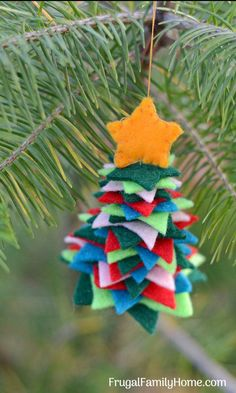 DIY Felt Christmas Ornament, Aren't these handmade felt Christmas tree ornaments so cute. We made a few and they are easy to make. If you are looking to make a few easy homemade Christmas ornaments you need to grab this pattern.