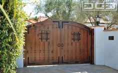 Spanish style wooden driveway entry gate.