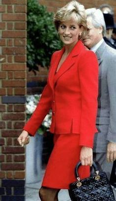 Princess Diana in a red suit.