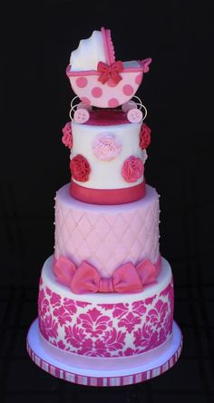 Shades of pink baby shower cake with royal icing stenciling,...