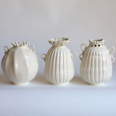 Whimsical Assorted White Bud Vases by American ceramic artist Frances Palmer. 6 x 7 in, $275 ea. via Frances Palmer Pottery