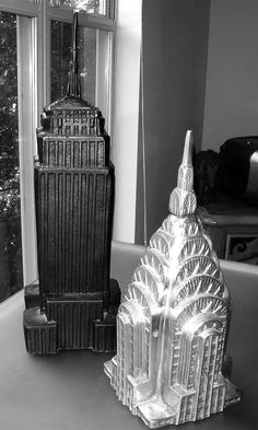 Pottery Barn statues of the iconic buildings. Empire State Building And The Chrysler Building.