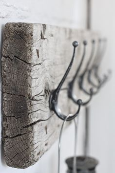 diy scrap wood coat rack or key holder? - love the distressed, old wood and simple look  I have the hooks!!. Just need to find the perfect board  Very cute. I have the board,  need the hooks