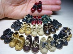 well how 'bout these ADORABLE little.....and i mean little....boots? :-) by a miniature artist in japan........click through for some darling close-UPS of the boots in particular!!! :-)