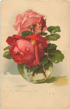 one red, one pink roses & bud in clear glass vase