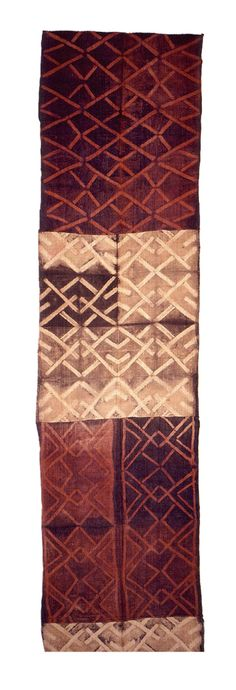 Africa | A man's ceremonial dance skirt with two panels of red and brown and two of tan and brown that are sewn together to form one long panel. All panels have interlacing patterns created through resist-dyeing | Raffia palm fiber | Democratic Republic of Congo, ca. early 20th century