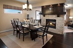 """Loving the 2sided fireplace and dark wood floors. With the """"right"""" accessories this space would be beautiful."""