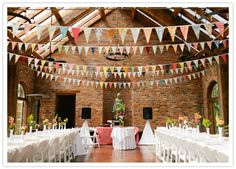 the bunting decor was created by the bride using vintage bedsheets. I love bunting! Its so adorable!