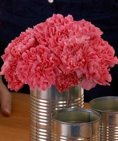 A backyard party or barbecue doesn't call for elaborate decorations, just something fun for the table―like this rustic, charming, and easy centerpiece. It's so simple—as this video shows, you can assemble it in minutes—you can make it with your kids.