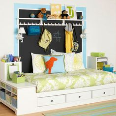 Under the Bed ~ Storage space can be found high and low in a child's room. This custom-made bed boasts handy underbed drawers, which are a terrific spot to stash specialty items such as out-of-season clothing or bulky sports equipment. Shelving units built in to each side of the bed house storage bins that help corral smaller items, such as school supplies and books.