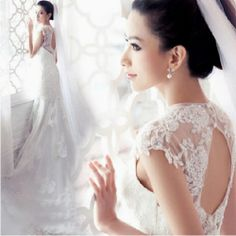 Glamorous lace cap sleeved bridal dress on Wanelo