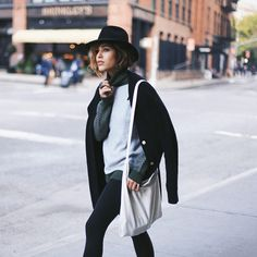 Your Holiday-Outfit Idea Handbook #refinery29 NYC-based model/fashion blogger Christina Caradona is making a strong case for comfy pants on her feed, @troprouge. Her oversized-turtleneck-and-cardigan duo helps balance the black leggings.