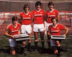 players from Manchester United posing for the club's first adidas kit deal with SHARP