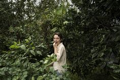 Forraging in the garden. Portrait. Fruit and flowers. Libby Brickell Flowers. Photographed by Alecia Honey.