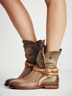Tyler Ankle Boot | Luxe leather boots featuring distressed detailing for a worn-in look. Snap button closures along the shaft can be opened for a versatile wear. Exposed inner zip for an easy on-off. Adjustable belted buckle accent around the ankle.
