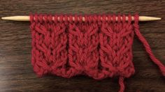(This video knitting tutorial will help you learn how to knit the downward slipped double cable stitch. This cable pattern consists of a row of interlocking arrows that point down. It's a great motif to use on blankets or as an accent on sweater sleeves and other garments..