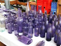 Adventures in antiquing led to this eye catching vintage purple bottle display.