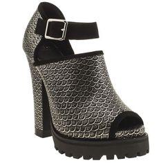SHELLYS London bring us a sleek silvery scallop printed heel that we love. The leather high heel features a sweet peep-toe, with a suede ankle strap and silver buckle detailing. A chunky cleated sole unit and a 14cm block heel.                                    <br><br><ul><li>Leather upper</li><li>Fabric lining</li><li>Rubber sole unit</li><li>14cm heel</li></ul>
