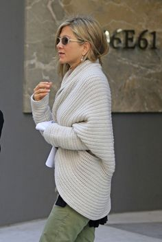 Jennifer Aniston goes furniture shopping on the Upper East Side in New York City, with fiance Justin Theroux. The Wanderlust actress could be seen sporting a tattoo with her dog Norman's name on her foot, in remembrance of the pooch's death in 2011. The couple, who are due to marry this year, stopped by the Interior Design Building to shop at O'Brien New York.