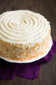 Hummingbird Cake - banana cake with pineapple and pecans, covered in cream cheese frosting and toasted coconut. Perfect for Easter!
