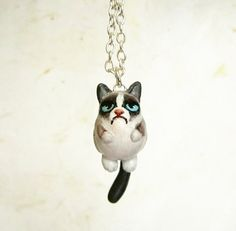 Handmade Polymer Clay Grumpy cat necklace.   The grumpy cat is a funny and unique cat with a strange facial expression. He looks angry but he's a lovely and cuddly cat! I like the grumpy cat and I made this nice pendant from polymer clay. The cat is chubby and his tail moves! Take always with...