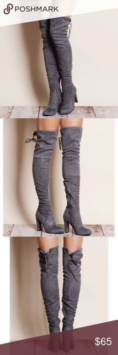 Grey Suede Over the Knee Boots Over the knee Faux suede boots with a tie back. True to size. This is an actual pic of the item - all photography done personally by me. PRICE FIRM. NO TRADES DO NOT BOTHER ASKING. Qupid Shoes Over the Knee Boots