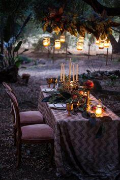 Wine chevron tablecloth, gold candelabra, autumn dining