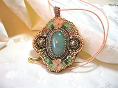Embroidered Beadwork Pendent, Necklace. $120.00, via Etsy.