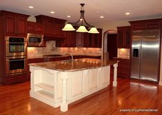 Two Tone Kitchen Cabinets. Light brown wood cabinets on island with white marble… – White N Black Kitchen Cabinets Cherry Wood Kitchen Cabinets, Painted Kitchen Island, Cherry Wood Kitchens, Espresso Kitchen Cabinets, Solid Wood Kitchens, White Kitchen Island, Dark Cabinets, Wooden Kitchen, Wood Cabinets