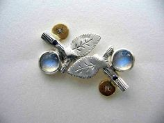 JENNIFER MARTIN: Earrings- Sterling silver, fine silver, 18ct gold, blue moonstone, diamond.