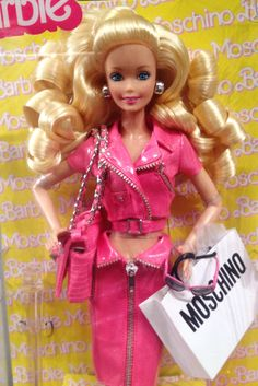 """Moschino also wins the award for this season's most coveted front-row swag: an actual Barbie. I overheard several editors say they were taking them for """"their kids."""""""