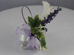 Lavender Wrist Corsage Too traditional for the dress, but pretty