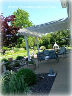 We installed an aluminum white pergola kit ordered from Lowes to our back patio when we lost our two patio shade trees. White Pergola, Wood Pergola, Deck With Pergola, Cheap Pergola, Covered Pergola, Backyard Pergola, Pergola Plans, Pergola Kits, Small Pergola