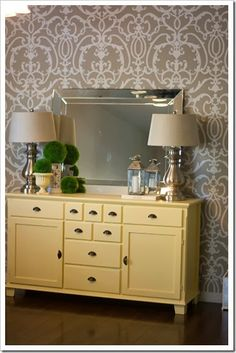 Love the butter yellow paint with the taupe wallpaper and a hint of green decor. Try Devine Butter, Devine Maple and Devine Ray to find the perfect soft yellow. Dining Room Paint Inspiration, Ikea Markor, Ikea Buffet, Home Bedroom, Bedrooms, Dream Bedroom, Grey Wallpaper, Cool Furniture, Living Room Decor