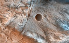 A Mass of Viscous Flow Features Viscous lobate flow features are commonly found at the bases of slopes in the mid-latitudes of Mars and are often associated with gullies.