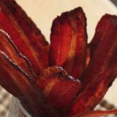 Candied Bacon  How do you make bacon better? In this video, Chef John shows you how, combining bacon with a quick brown-sugar and maple-syrup glaze to create candied bacon! Chef John also reveals the best type of bacon to use for this recipe. It's super easy! Video @ http://allrecipes.com/video/590/candied-bacon/detail.aspx