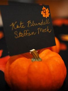 Pumpkin stems make perfect holders for escort cards // mini pumpkins can double as favors.