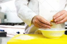 Chef hands with egg and flour