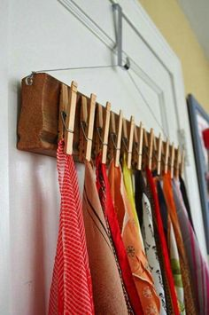 Clothpins to hang scarves. Great idea! Could be made a little prettier, though.