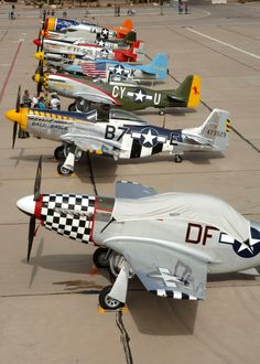 Pilots, crewmembers and spectators gather around several P-51 Mustangs and a P-47 Thunderbolt (rear) March 4 after a busy few days at the 2007 Heritage Conference at Davis-Monthan Air Force Base, Ariz.