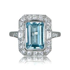 A beautiful aquamarine and diamond engagement ring, adorned with approximately 1 carat of diamonds. The center aquamarine is an emerald cut.