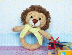 Lion baby rattle crochet pattern designed by Amigurumi Today